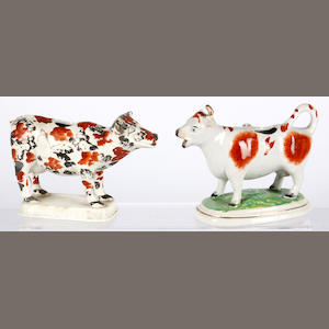 Two pottery cow creamers