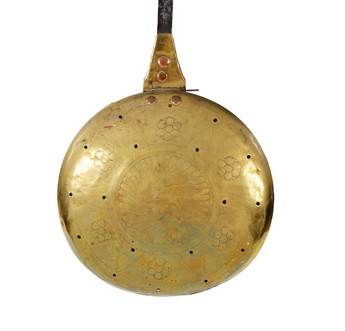 An 18th century brass warming-pan, Dutch