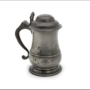 A George III quart dome-lidded tulip-shaped pewter tankard