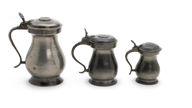 Three Glasgow Imperial lidded bulbous pewter measures First-half 19th century