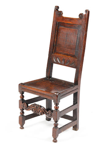 A late 17th century oak backstool