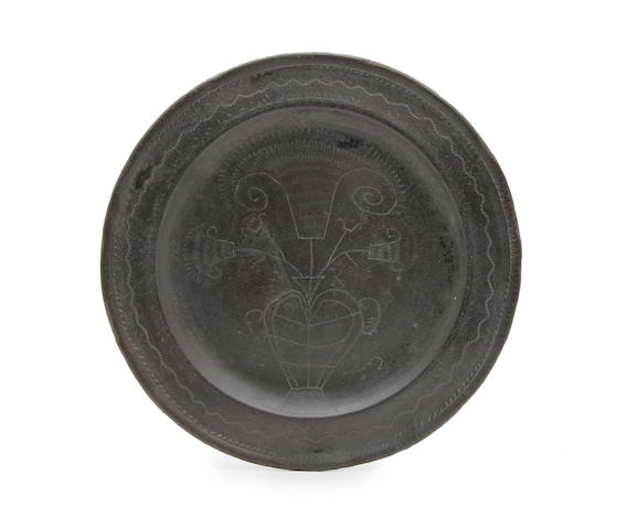 A George I wriggle-work pewter plate, dated 1725