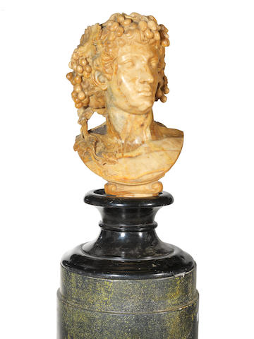 An 18th century style resin bust of Bacchus on a pedestal