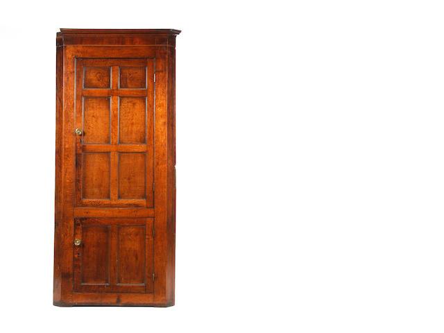 A George III oak  standing corner cupboard