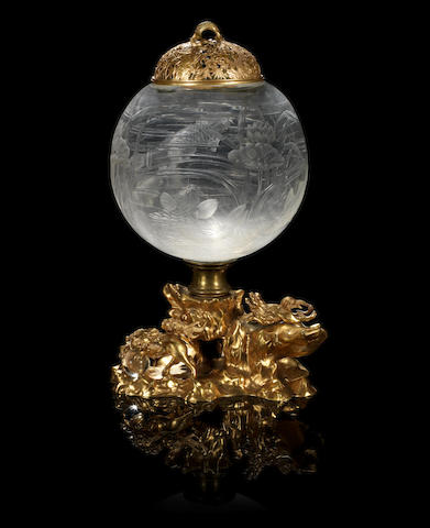 A large French ormolu-mounted glass fish bowl, engraved in the Oriental taste, and gilt-metal cover, circa 1900, possibly Baccarat