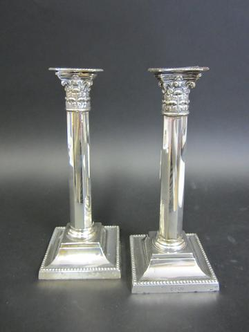 An Edwardian pair of silver candlesticks by Richard Martin & Ebenezer Hall, Sheffield 1903  (2)