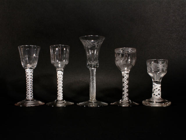 Four opaque-twist glasses and an airtwist wine glass, 18th century