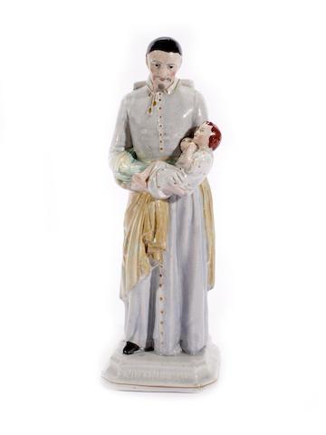 A rare Staffordshire figure of St Vincent de Paul, mid 19th century
