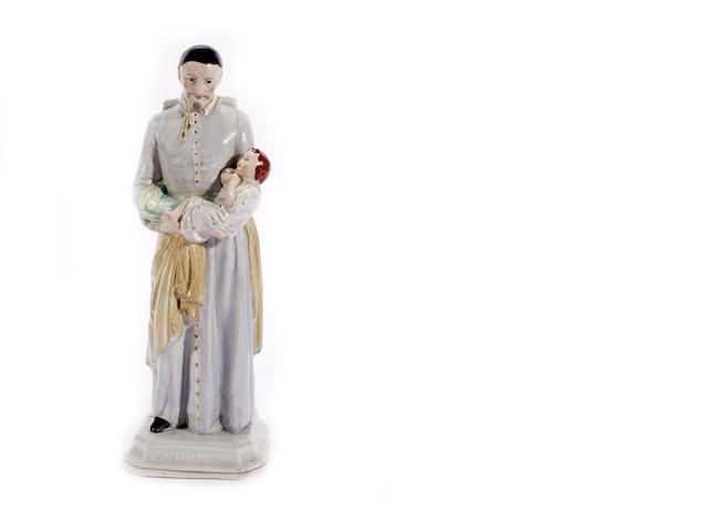 A rare Staffordshire figure of St Vincent de Paul, mid 19th century