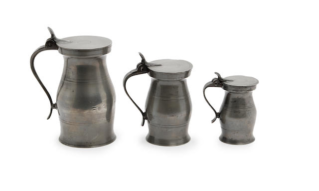 Three Scottish lidded baluster pewter measures First-half 19th century, Edinburgh