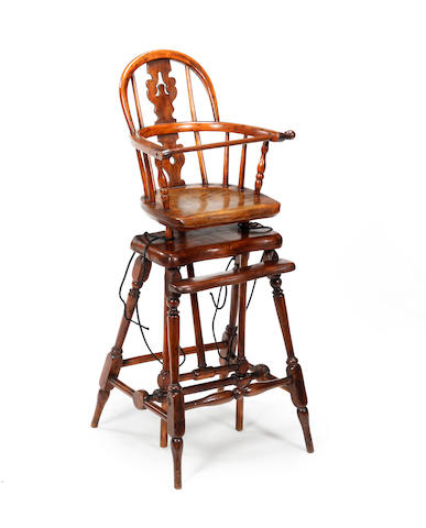 A yew, elm and ash child's high Windsor chair Late 19th century