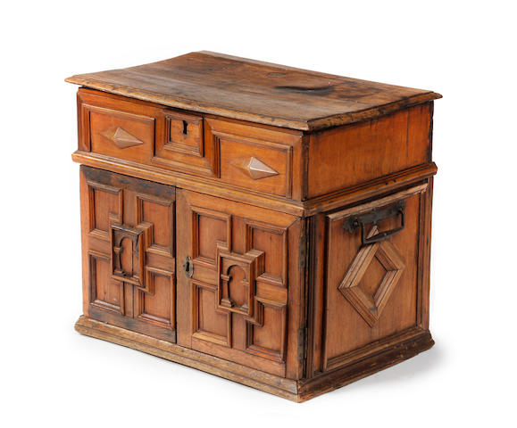 A 17th century and later oak and walnut table cabinet North European