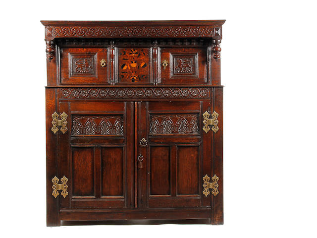 A late 17th century and later oak and marquetry inlaid court cupboard