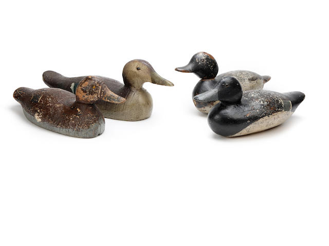 A collection of four painted duck decoys
