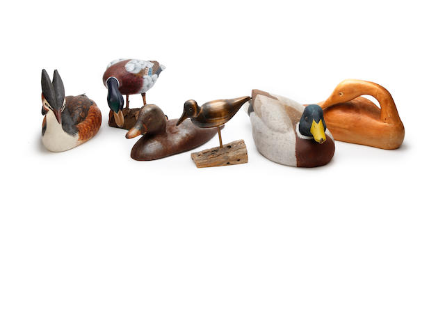 A group of three modern duck decoys
