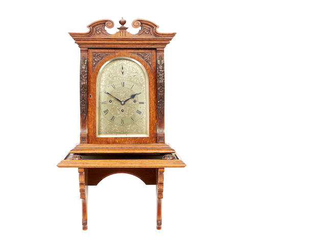 A late 19th century oak quarter striking bracket clock by Benson, London