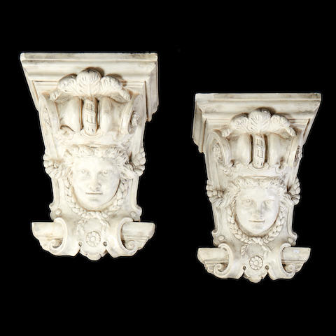 A pair of 18th century style plaster wall brackets
