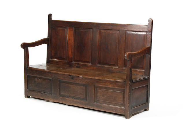 A mid-18th century oak box settle