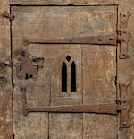A small oak boarded cupboard In the manner of a 15th century aumbry