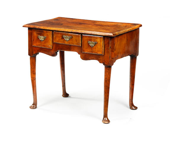 An 18th century and later fruitwood and elm lowboy
