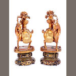 A pair of Indo-Chinese carved and lacquered wood temple models of deer