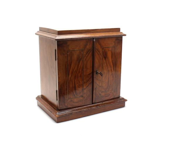 A Victorian walnut table cabinet