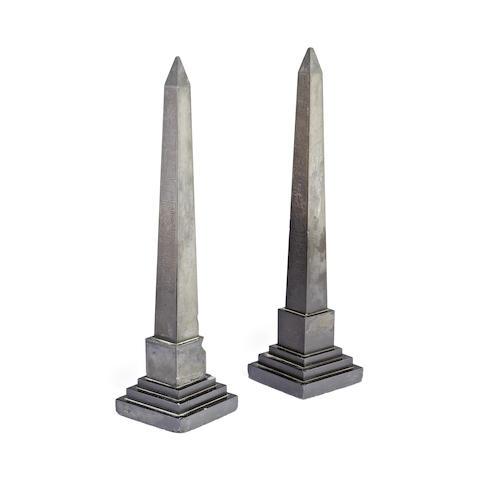 A near pair of early 20th century black slate obelisks