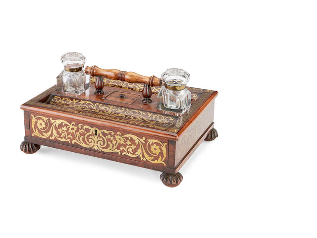 A Regency rosewood and cut brass inlaid desk set