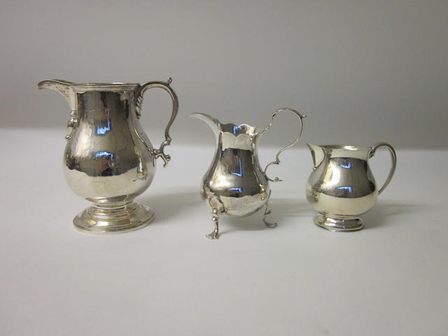 A silver cream jug, by R Garrard London 1931,  (3)