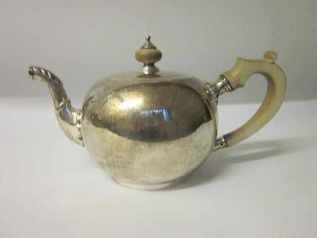 A silver teapot by R Garrard London 1931,