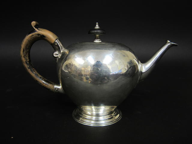 A Victorian silver bullet shape teapot by Charles Stuart Harris, London 1899