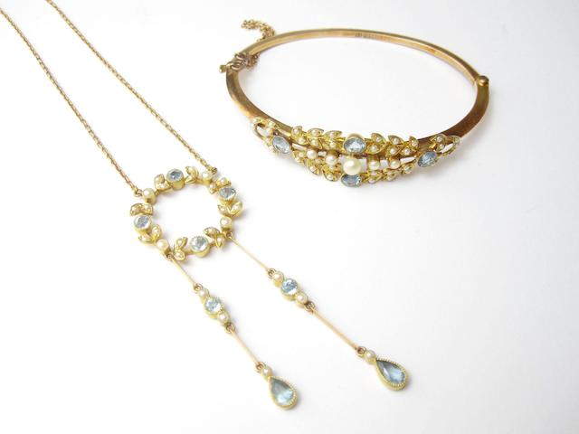 An aquamarine and seed pearl bangle and pendant (2)