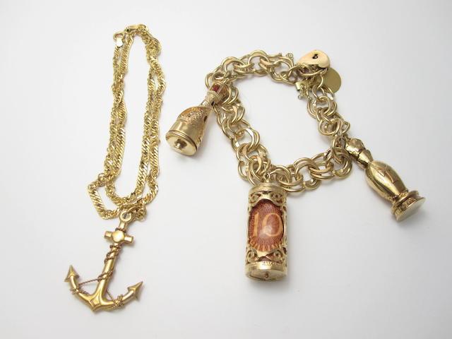 A 9ct gold charm bracelet (2)