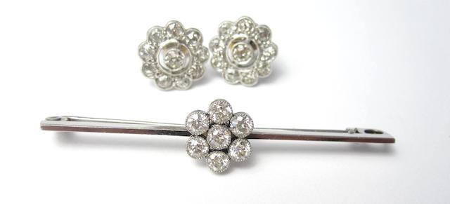 A pair of diamond cluster earrings and a brooch