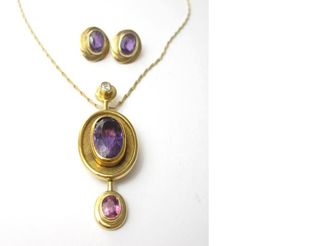 A gem-set pendant and a pair of amethyst earrings