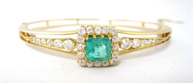 A late Victorian emerald and diamond bangle