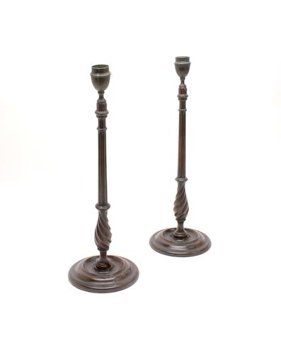 A pair of early 20th century mahogany candlesticks