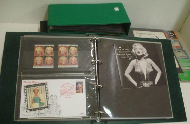 Two albums containing a large collection of Faga cards, and a guide to postcards, a collection of postcards, 1st Day Covers, stamps and other printed ephemera relating to Marlyn Monroe, and a large collection of phone cards in three album page wallets.