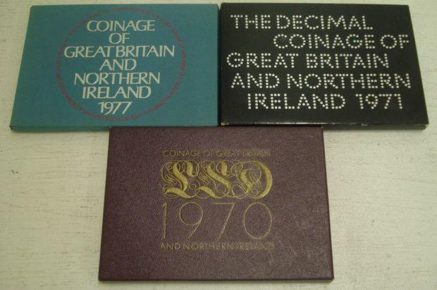 "Three Great Britain and Northern Ireland cased proof coin sets, 1970, 1971 & 1977, twelve other cased un-circulated coin year sets, two other cased coin collections and three £1 banknotes, also a cased set of Commemorative medals, ""Railways Act 1921""."