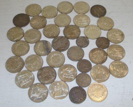 Twenty eight 'Hurcules' 10 Franc silver coins, various dates and an 1875 2 1/5 Gilder coin and other coins.