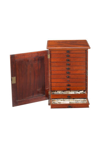A rare Charles Tennant mahogany cabinet of minerals, rocks and fossils,  English, dated 1858,