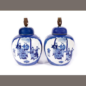A pair of Chinese blue and white vase and covers, Kangxi marks