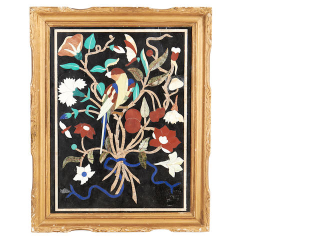 A 20th century pietre dure panel depicting a bird amongst flowers