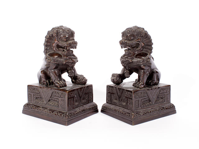 A pair of Chinese bronze buddhistic lions