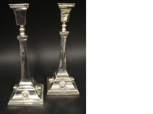 A silver pair of candlesticks,  makers mark worn, Birmingham 1932