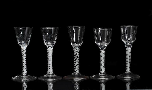 A pair of opaque-twist wine glasses, and three other opaque-twist glasses, 18th century
