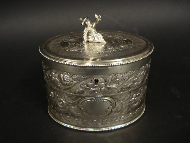 A George III silver oval tea caddy by Robert Makepeace & Richard Carter, London 1777