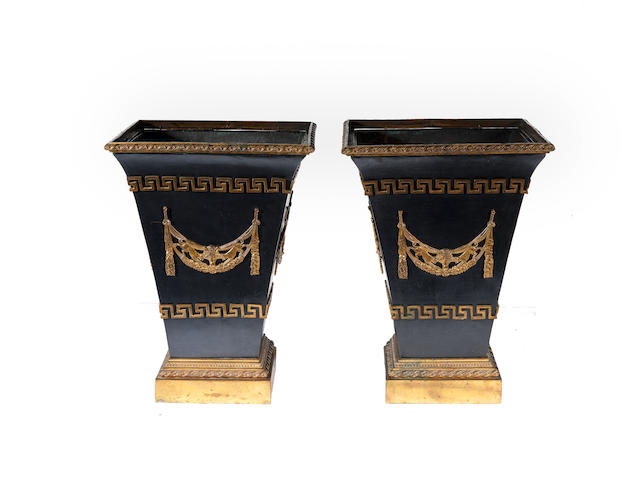 A pair of early 19th century Empire style gilt and patinated bronze jardinieres