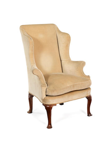 A George II walnut wing armchair