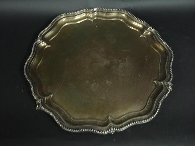 A circular silver salver
